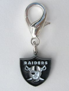 Officially Licensed NFL Team Charms Perfect gift for four-legged fans of the Oakland Raiders Nation! These jewelry-quality charms are crafted from antiqued, lead-safe pewter, and are hand- enameled. Made in the USA.  Size: 5/8 x 1 1/2 in.   Made in ...