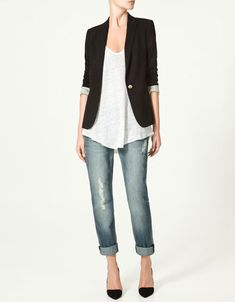black blazer, white loose shirt, light denim jeans