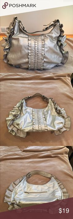 Beautiful Pewter/Silver Purse This Silver/Pewter hobo purse will definitely catch someone's eye. It has a beautiful Ruffle detail. Brand New without tags. Never been used. Bought at a boutique. Bags Shoulder Bags