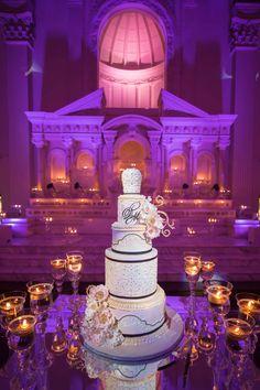 Tall White & Black Cake with Gold Details  Photography: KLK Photography Read More: http://www.insideweddings.com/weddings/greek-orthodox-church-ceremony-glamorous-purple-gold-reception/730/