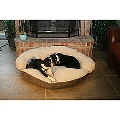 @Overstock.com.com - Round 35-inch Green Microsuede Bolster Sherpa Dog Bed - Make your pet feel like a member of the family with their own microsuede dog couch bed. A large, plush round surface with high-loft polyester fiberfill is combined with a stain-resistant poly sherpa and microsuede shell. Holds up to a 70-pound pet.  http://www.overstock.com/Pet-Supplies/Round-35-inch-Green-Microsuede-Bolster-Sherpa-Dog-Bed/6373440/product.html?CID=214117 $52.03