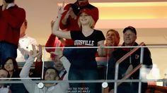 Jennifer Lawrence at UofL vs UK basketball game... bless her heart she has on the wrong colors