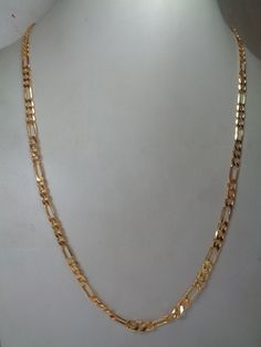 2 mm thick Gold Filled Figaro Chain (Nickel & Lead Free) made from Brass available in 21 inches length is readily available at wholesale prices direct from India based Manufacturer and Supplier. Sold per chain.  Product Specifications: Material : Brass Thickness: 2 mm Size (Width) : 5 mm (approx) Length/Chain : 21 inches Lock Type : S-Lock Chain Polish : Gold Filled Chain Type : Figaro Chain  Port of Dispatch = Jaipur, India  Gold filled is an actual layer of gold-pressure bonded to base…