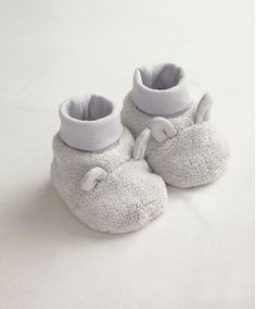 Unisex Welcome To The World Grey Faux Fur Booties - Accessories - Mamas & Papas You can find these in 'W is for White' Unisex Nappy Cake www.nappycakesasuniqueasyou.com