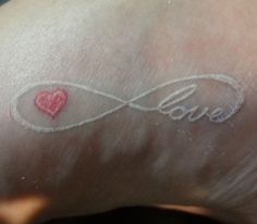 White ink infinity love tattoos with small heart. No black ink.