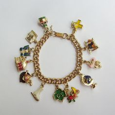 SOLD Vintage Girl Scouts charm bracelet with complete set of 12 enamel 3D charms by trendybindi, $125.00