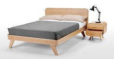 A kingsize bed with an oak frame.