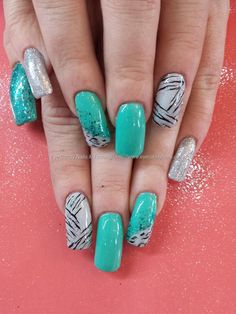 Mint green and silver gel polish with freehand leopard print nail art