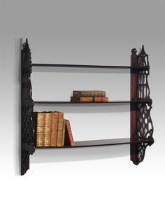 nineteenth century lace wood display cabinet. shaped pediment and