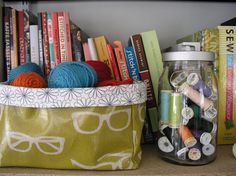Fabric bins! These little containers are perfect for holding odds and ends, from bathroom clutter to craft-room supplies.
