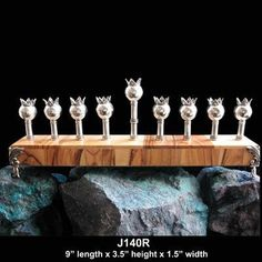 Sterling silver Pomegranate Menorah on wood base with sterling feet. Judaica Kingdom
