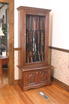 Use a lockable display case to show off guns or trophies. This cabinet features walnut, a classic for this type of cabinet project.