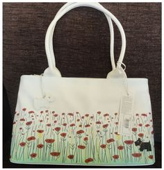 I love the classic Radley Poppy Fields design. This large tote is mine.
