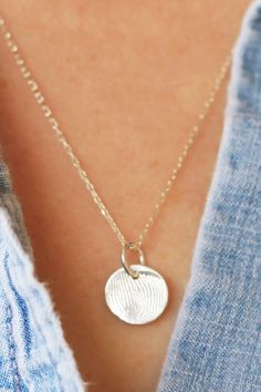 Wear a piece of your loved one close to your heart. Sterling silver fingerprint disc.