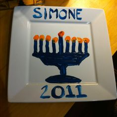 Another Jewish kid named Simone! Paint the menorah on the plate, dip child's thumb in orange paint for the flames. Write child's name and the year and you have a beautiful keepsake. Hanukkah Crafts, Hannukah, Holiday Crafts, Hanukkah Menorah, Holiday Ideas, Food Gifts, Craft Gifts, Craft Paint, Preschool Activities