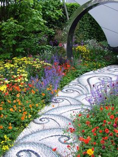 River stone mosaic path.  I love mosaics for outdoor spaces. Really must start on some projects this spring!