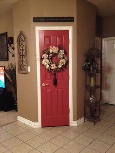 Kitchen pantry door painted a beautiful red called salute red by Sherwin Williams