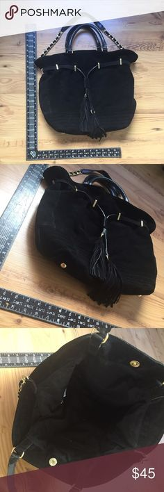 Genuine Suede Zara Tote This suede Zara tote is the perfect every day bag! Super soft and has a shoulder strap. Snap closer with one inside pocket and complete with gold hardware. Cinch tassel to pull top of bag tighter. Only used once. Zara Bags Totes