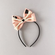 Oversized Blush Pink Felt Bow with Kitty Cat Face and Rope Whiskers. Attached to a hard satin headband that fits aprox. ages 1 year old to adult.  *** PLEASE READ SHOP/SHIPPING POLICIES BEFORE PURCHASING***  *** Some pieces may contain small parts. Do not leave children unattended while wearing accessories from Giddy Up and Grow. Customer acknowledges full responsibility.***  Handmade with great care and detail since 2010 ©2010-16 Giddy Up & Grow