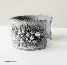 Embroidery Bracelets Ideas Bead embroidery cuff bracelet with freshwater pearls in grey gray silver peacock, mauve and cream white - Winter lace - Gorgeous! Bead embroidery cuff bracelet with freshwater by jewelrywithsoul Embroidery Bracelets, Bead Embroidery Jewelry, Textile Jewelry, Fabric Jewelry, Beaded Embroidery, Jewelry Crafts, Jewelry Art, Beaded Jewelry, Handmade Jewelry