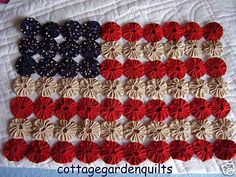 A flag quilt made from fabric yo-yo's. Love it!