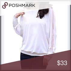 NWT white blouse with mesh cutouts ➖NWT ➖SIZE: Small, Medium ➖STYLE: A loose top that comes back together at the bottom with a line of mesh in the middle of the sleeves. Tops Tees - Long Sleeve