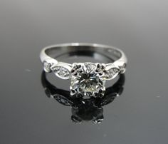 1940s Platinum Engagement ring with .79ct Diamond Center   RGDIA706D. $2,615.00, via Etsy.