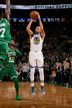 e38615f75571 Stephen Curry of the Golden State Warriors shoots the ball against the  Boston Celtics on November