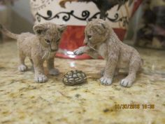Kerri Pajutee, Paizley Pawz, IGMA fellow - lion cubs, molded plastic animal body that was heavily customized and furred