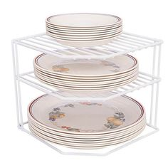 """Mfr #: 40316, Color: White, Perfect for utilizing wasted corner space, Holds approximately 8 to 10 pieces of dinnerware, Ideal for kitchen, bath or closet, Sturdy PE coated steel constructionShipping weight:1.5 lb Color: White Quantity: 1 Length: 8"""" Width: 9"""" Height: 9""""."""