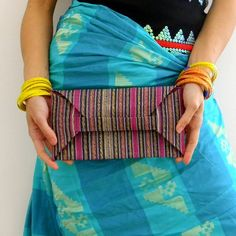 ORIGAMI CLUTCH - stripe abaca bag.  via Etsy.