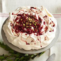 Cloudlike puffs of meringue and whipped cream will send guests into seventh heaven. Named to honor the grace and elegance of ballerina Anna Pavlova, the airy dessert resembles a dancer's tulle tutu.  /