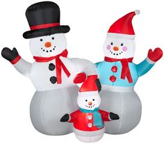 2013 Snowman Family Christmas Inflatable.  Bright and colorful Snowman Family are ready to greet all those who pass by by with big Holiday cheers.  Very adorable and heartwarming Christmas Holiday Scene.