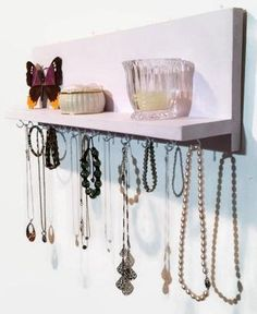 """The Renewed Decor Necklace Rack and Shelf is a painted pine wall mount long necklace holder and jewelry organizer that was specifically designed to organize necklaces, link type bracelets even hook dangle earrings and other accessories. This necklace holder is wonderful for girls, teens and women of all ages. **As with all items in our shop, shipping is FREE**PRODUCT DIMENSIONS: This Jewelry Hanger comes in lengths 12"""" to 20"""" with 11 to 19 hooks depending on length. The height of a..."""