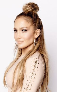 The half up top knot is one of the rising hair trends of 2016. JLo rocks it well!!