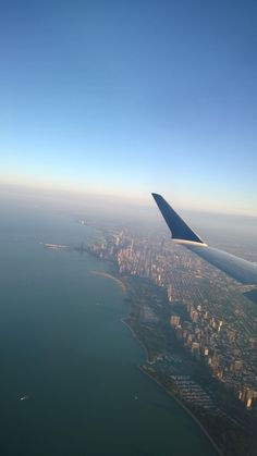 Flying over Lake Michigan, Chicago. Photography by www.tdavispainthouse.com