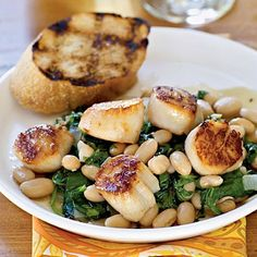 Seared Scallops with Warm Tuscan Beanshttp://www.myrecipes.com/quick-and-easy/15-minute-recipes/easy-scallop-dishes-10000001970005/page7.html