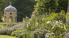 A colouful flower border with the folly in the background