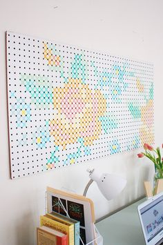 Make a big and beautiful impact in your home with this DIY Painted Cross Stitch Art. So easy to make, but looks like a true work of art!