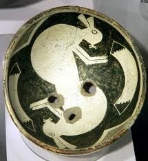 Mimbres bowl depicting two rabbits with throwing sticks, southwestern New Mexico, 1000 - 1250 C.E. Mimbres pottery was made by women.