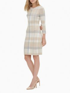 Elegant and sleek, this classic pullvoer sweater dress is made with an allover plaid, a crewneck, sleeves and a fitted sheath silhouette. Sleeveless Hoodie, Hoodie Dress, Short Sleeve Dresses, Dresses With Sleeves, Women's Dresses, Casual Night Out, Plaid Dress, Summer Dresses For Women, High Fashion