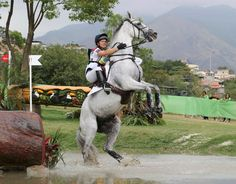 Gemma Tattersall (GBR) of United Kingdom riding Quicklook V attemps to cross a water obstacle
