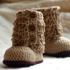 Little furry baby booties!!!  So adorable!  I really need one more baby so I can just make a bunch of stuff...