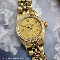 A 1986 Rolex Ladies Oyster Perpetual Ref. 67197. This beautiful timepiece features a 14K yellow gold watch case with a champagne-colored dial with applied, yellow gold baton markers and a 29-jewel, automatic caliber 2130 movement. This watch also comes equipped with an original Rolex 14k yellow gold Jubilee Bracelet as well. (Store Inventory # 9614, listed at $4500.)  #rolex #oysterperpetual #gold #yellow #14k #wristwatches #simple #timeonly #ladies #vintage #watch #classic #watches #stawc