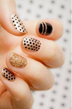 Gold and black holiday nails
