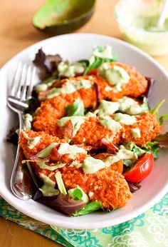 Buffalo Chicken Salad with Creamy Avocado Ranch Dressing. Next time I would only coat one side of the chicken with buffalo sauce so it wouldn't be so spicy. I also used reduced fat ingredients for the dressing. So yummy!