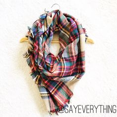 """Cozy Classic Tartan Blanket Scarf Soft and cozy blanket scarf in a classic tartan plaid pattern. Fringe detail along the edges. Bright threading throughout. Measures approximately 55"""" by 55"""" and can be worn many ways. 100% acrylic. This is BNWT - Retail. Makes a wonderful gift for you or a friend! First picture is filtered. Color is true in remaining photos. Please ask for a custom listing. Thanks for looking! Boutique Accessories Scarves & Wraps"""