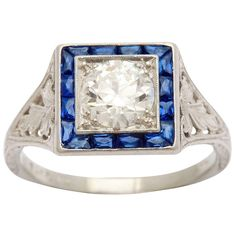 1923 Tiffany Diamond, Sapphire and Platinum Wedding Engagement Ring. A beautiful 1923 custom made Tiffany & Co. platinum ring holding a 1.14 carat round brilliant cut diamond G VS1 (GIA #5151721643), surroounded by 16 fancy cut sapphires = .50 carats. Tiffany mark.