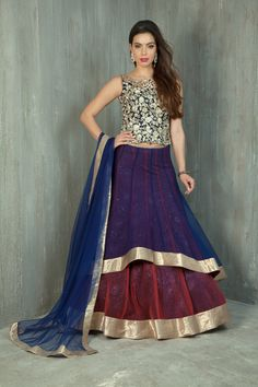 Net two layer ghagra with lace lining and rawsilk corset embellished with zari and stone work and net dupatta
