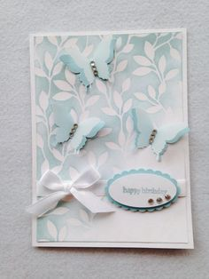 Birthday card made with whisper white and soft sky cardstock, Irresistible yours DSP, vellum, soft sky marker, butterfly punch, white ribbon and rhinestones.